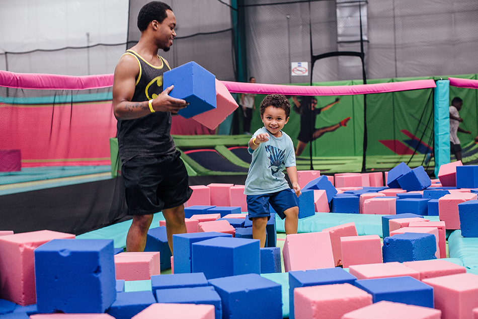 Dad and son in foam put at trampoline park in Lewes, Delaware